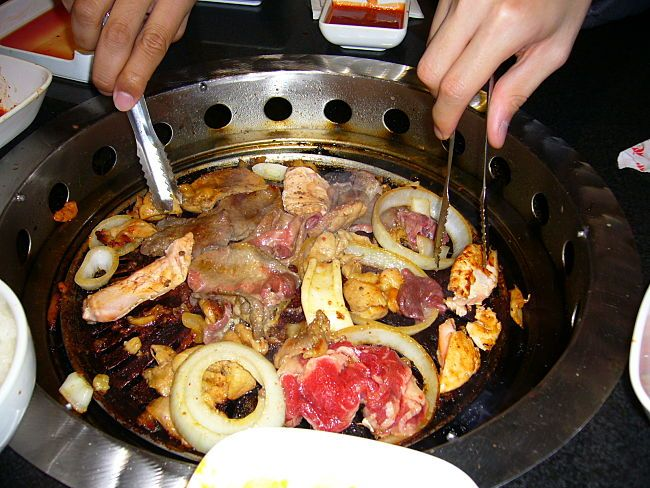 The communal cooking aspect of a Korean barbecue adds to charm and appeal. Each friend or guest can choose what they want and cook it themselves.