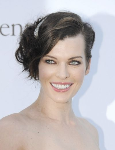 Milla Jovovich's glamorous updo worn to the side with a sparkly hair accessory.