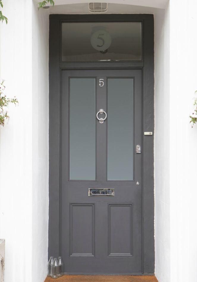 Grey front door with chrome knockers etc