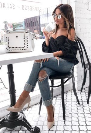 This outfit includes white bags's bags, beige heels of the brand heels, blue jeans of ripped jeans, and black Dior's corsets