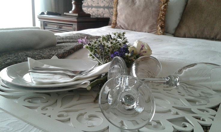 Preparation for a romantic weekend getaway. #bellacasarooms #romance #champagne #roses