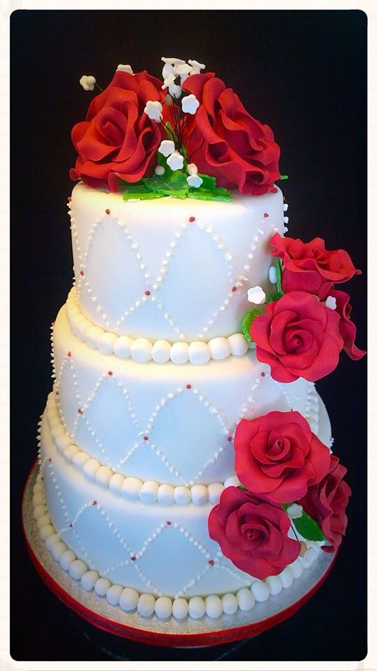 3 tired wedding cake with red sugar roses