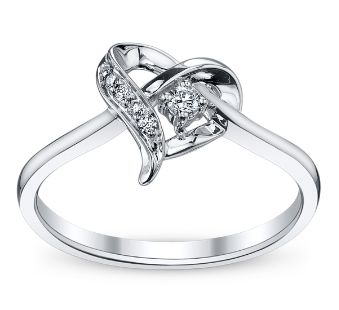 Let her know that she holds your heart with an elegant shaped diamond  heart promise ring by Cherish. Sku: 0385101