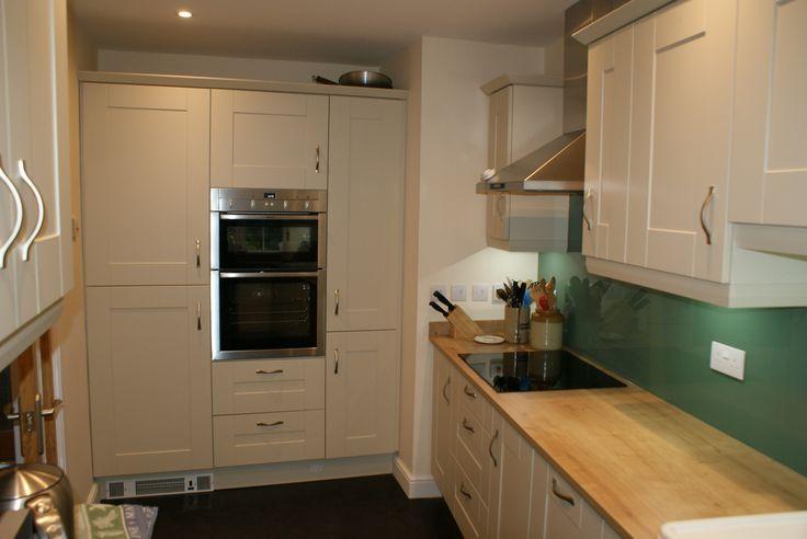 Quinag Matt Ivory Kitchen with Arlington Oak Laminate worktop and