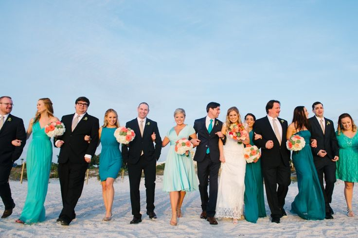 Eclectic Aqua and Coral Beach Wedding and the guys could wear navy suites! You could get your aqua color too!!!