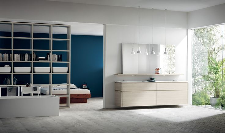 """The """"Fluida"""" Wall System enters the bathroom: this solution entails load-bearing side panels that further increase the composition possibilities, here in Seagull Grey Decorative Melamine. Also for use as a partition wall between communicating rooms."""