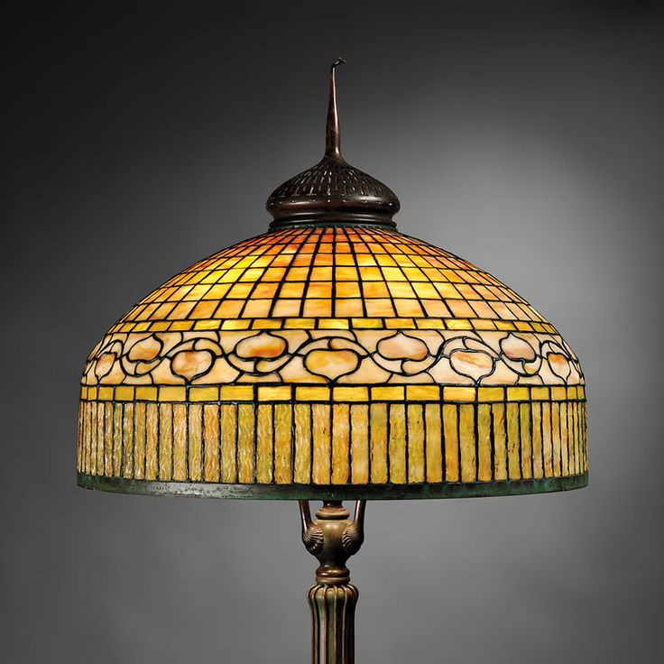 A tiffany studios curtain border floor lamp new york circa 1908 mosaic art glass and bronze having a 24 inch shade came out of a new hampshire