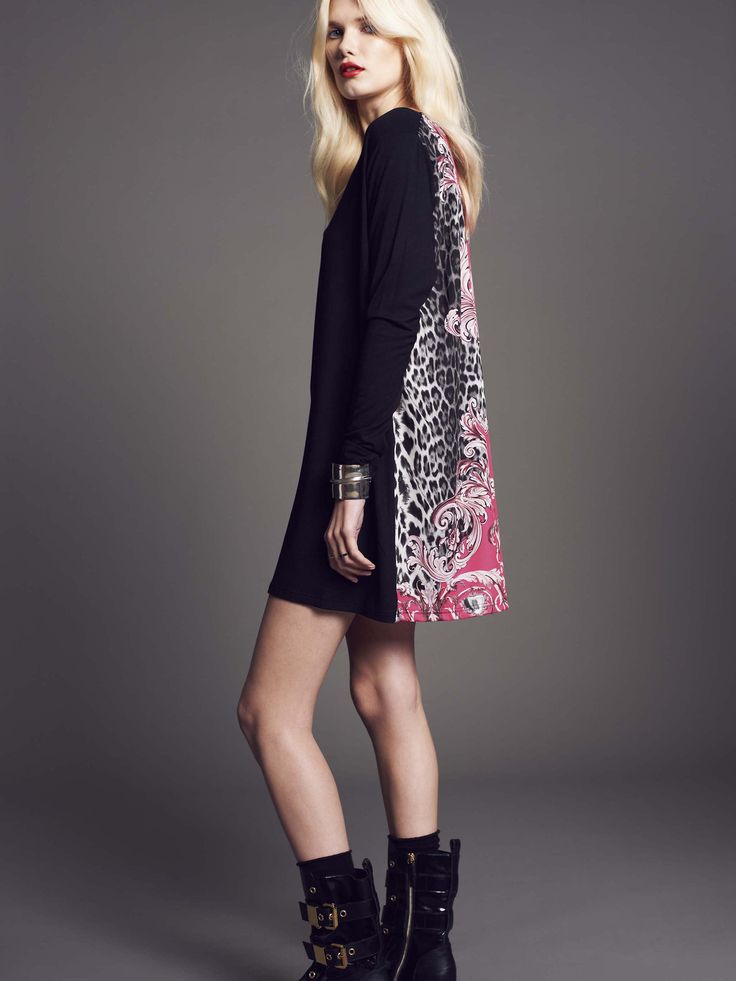 Model wears Naughty Dog mini #dress, realized in two different fabrics: jersey on the front and printed silk on the back.
