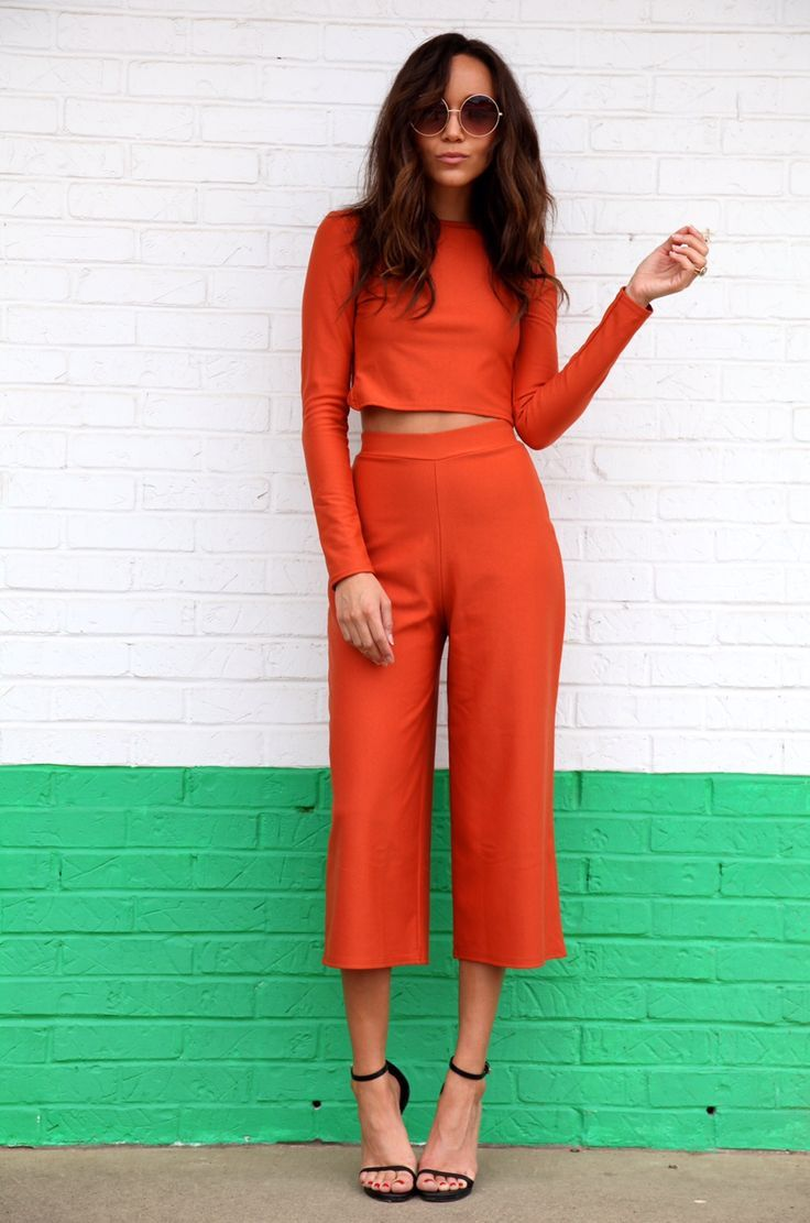 A bright co-coordinating two-piece with black heeled sandals.