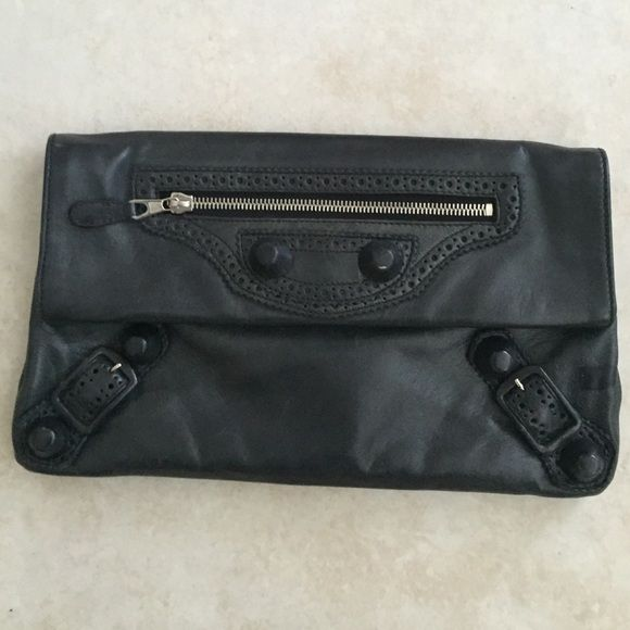 Balanciaga black leather clutch with dust bag Fabulous Authentic Balenciaga clutch!! Black leather, two compartments inside. Lots of room for your goodies. Shows signs of wear see picture leather rubbed off on one tiny spot. It gets better with age. Balenciaga Bags Clutches & Wristlets