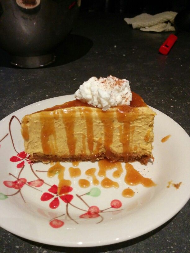 Ginger snap pumpkin cheesecake with homemade caramel drizzle and whipped cream