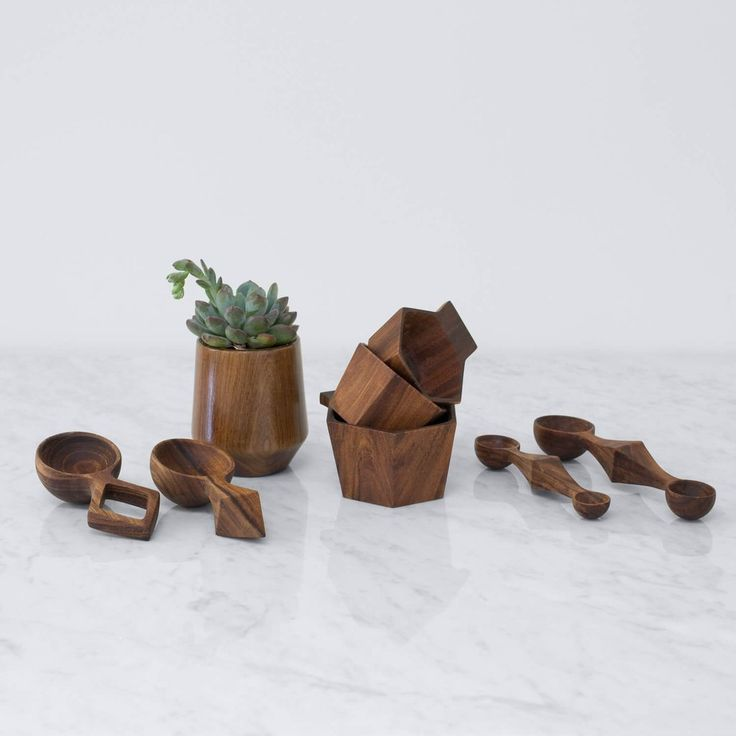 Hand-carved from a rich Tzalam wood, these measuring cups are made to last and come in a minimal, geometric design.