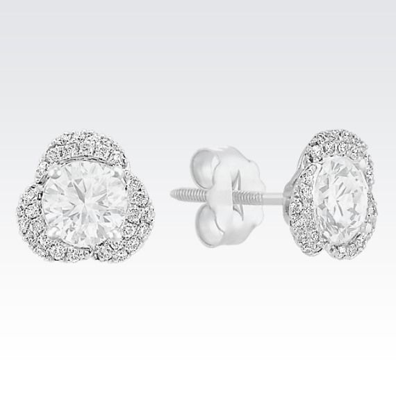 Give your solitaire earrings a whole new look with these sparkling diamond earring jackets. Sixty round diamonds, at approximately .16 carat total weight, form a unique halo around your earrings. Simply put the post of your solitaire earrings through the center of the earring jackets set in quality 14 karat white gold to create a fabulous combination. The jackets fit up to and look best with a .25 carat stone or a 4.1mm pearl in each ear. The diamond solitaire earrings pictured are not ...