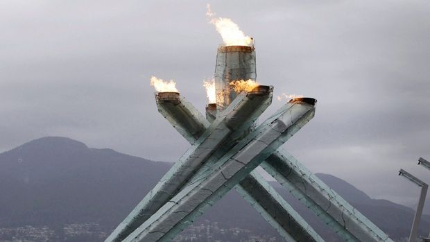 The Olympic torch burns at the 2010 Olympics in Vancouver, where some activists would like to see the 2014 Winter Games moved from Sochi, Russia.