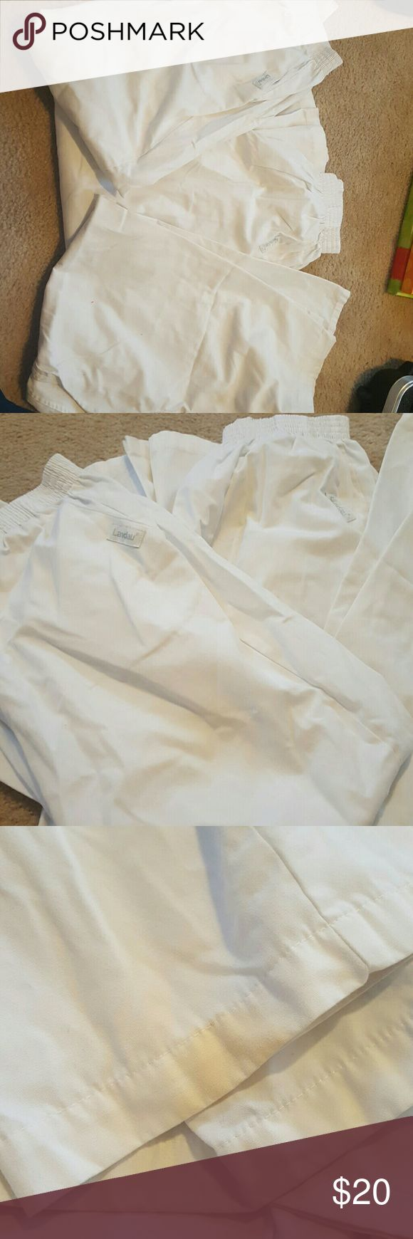 landau scrub pants has a few spots on bottom of pants but should be able to bleach out i havent tried and have no use for them anymore  2 are landau the other pair are another brand   they have been stored for a long time so needs to be bleached . Landau Other
