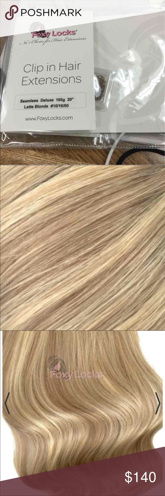 "FOXY LOCKS 165g hair extensions-latte blonde Latte Blonde, 165g, 20"" long,Seamless Clip In Made from Remy Human Hair 8 wefts (Full head):  One x 8"" wide with 4 clips One x 7"" wide with 4 clips Two x 6"" wide with 3 clips Two x 4"" wide with 2 clips Two x 1.3"" wide with 1 clip  Our Seamless wefts lay flat on your scalp making them virtually undetectable. Breakthrough Silicone band technology fuses & bonds every single strand of hair at the top of each weft reducing shedding and tangling…"