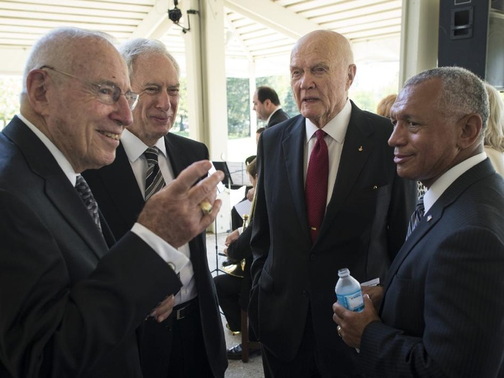 Neil Armstrong Memorial  Apollo 13 Astronaut Jim Lovell, left, former NASA Administrator Dan Goldin, Sen. John Glenn, third from left, and NASA Administrator Charles Bolden, right, talk at a private memorial service celebrating the life of Neil Armstrong, Aug. 31, 2012, at the Camargo Club in Cincinnati.