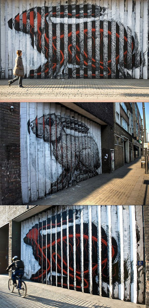 """Rabbit by ROA    Here's a story about another one of ROA's rabbits. """"The building's owners had granted the artist permission to create the piece, but they have been served with a removal notice by Hackney council, warning that unless they 'remove or obliterate the graffiti' within 14 days, a council contractor will paint over the wall and charge them for the service."""""""