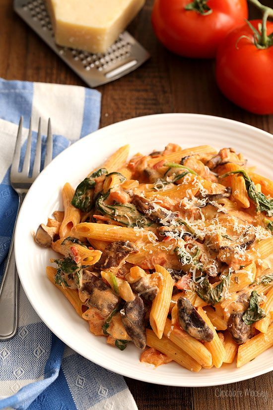 Creamy Tomato and Mushroom Pasta with spinach and homemade tomato sauce. Dish takes 30 minutes so you don't have to spend hours on homemade tomato sauce!