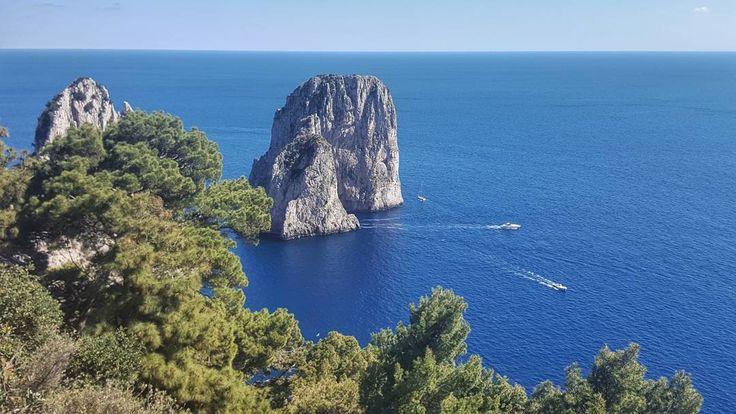 Faraglioni Rocks on the Island of Capri Italy  #capri #italy #island #travel #afternoon #faraglioni #rock #faraglionirocks #coast #sea #seaside #water #bluesky #galaxys6