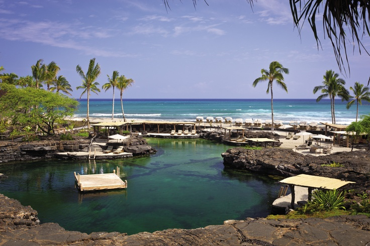 """Not your ordinary pool! @Four Seasons Resort Hualalai at Historic Ka'upulehu's  King's Pond is an """"aquarium"""" carved out of natural lava rock, letting guests swim with over 3,000 tropical fish. Fresh and ocean water fill the pond via subterranean channels."""