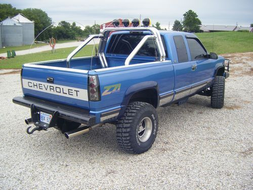 Blue Lifted Chevrolet Truck, it needs a bigger lift and then it would be perfect