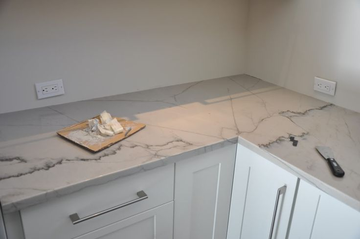 Calacatta Macaubus quartzite - harder than granite and marble, won't etch like marble. Love this - would look great in CC