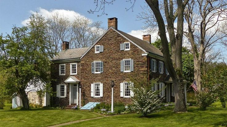 """Built circa 1825, this historic German farmstead in Bucks County, Pennsylvania, has undergone a """"museum quality"""" restoration, boasting heaps of original details and Colonial charm."""