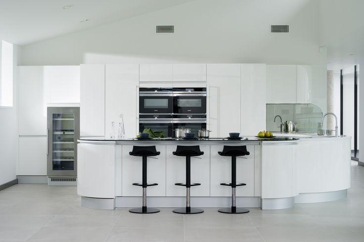 Pedini Artika cabinetry in High White Gloss, A Corian worktop in Designer White and Smoke Grey mirror glass back splash.