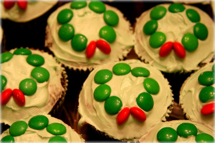 Christmas Wreath Cupcakes w/ M and M's. So easy!  Here's another fun and easy Christmas tradition. Instead of just cookies this year, why not make Christmas wreath cupcakes - they'd make great neighbor gifts too!