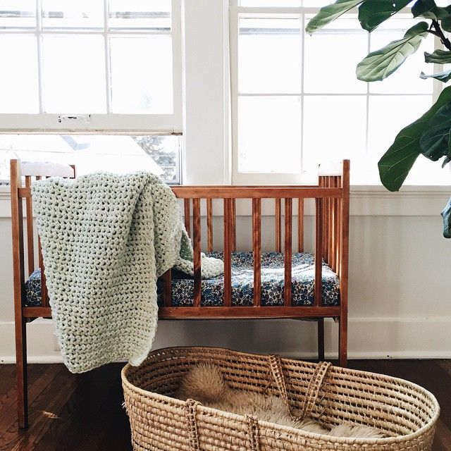 """minty knit made by my husband's mama hangs in our summer roommates' bassinet"""