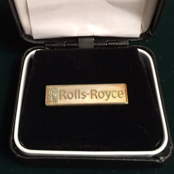 Rolls Royce Gold Pin Rolls Royce gold tone metallic pin, given out as employee holiday gift. Given to me by a past employee of the company. Comes in original box and includes additional pin guard as shown. Like-new, excellent condition and has never been worn. Rolls Royce Jewelry