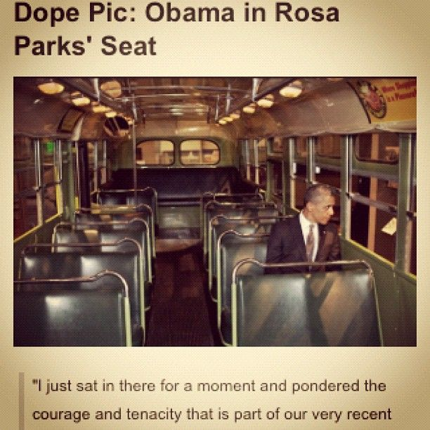 President Obama sits in Rosa Parks' bus seat.