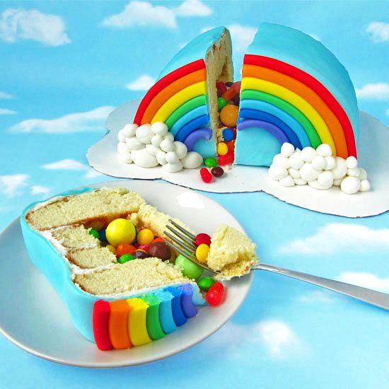 Rainbow Pinata Cake { step-by-step directions} ~ Surprise your family and friends when you cut into this beautifully decorated rainbow cake and candy spills out just like a piñata.