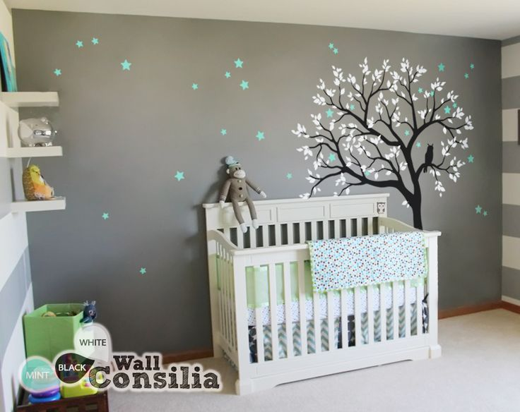 This dreamy tree with white leaves and with owl sitting on the tree branch watching the night sky is a wonderful addition to your babies nursery walls. Indulge your little one's imagination with this stunning vinyl wall decal set perfect for any nursery or bedroom. We think it's a great choice for gender neutral nursery! This tree mural sticker features dreamy scene –what could a little kid love more?   In Stock at www.wallconsilia.com