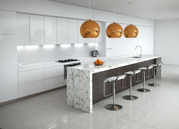 A Luxurious White Kitchen With Chrome Accents And A Lengthy Island In White  Marble With Black