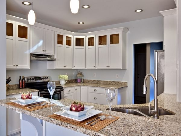 santa cecilia light granite countertops contemporary kitchen design white cabinets recessed lights