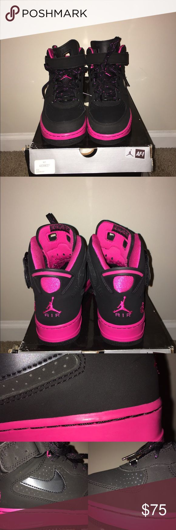 Girls AJF 6 Youth size 7 Girls Air Jordan Forces 6 in black and vivid pink. High top sneakers with Velcro straps. Worn twice. Has a few dark marks/defects (see 3rd pic) around the soles but barely noticeable. Shoes are in great condition. Grade school youth size 7, which can easily fit a woman size 9. Box is slightly damaged. Jordan Shoes Sneakers