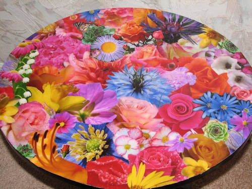 Decoupage table.... This one was done with her own flower pictures. I could totally do that! Would be so cute in a sun room or even a little girl's room. Think of the possibilities!