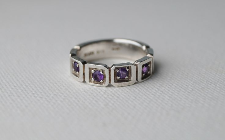 Vintage Sterling Silver Amethyst Ring - Wedding Band - Half Eternity Ring - Vintage Amethyst Ring - Vintage Ring - 5 1/2 K - Mint & Vintage by MintNVintage on Etsy https://www.etsy.com/listing/263131131/vintage-sterling-silver-amethyst-ring