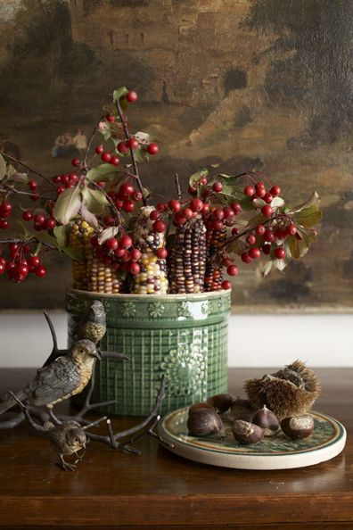 A green crock is perfect for displaying Indian corn and branches of berries.