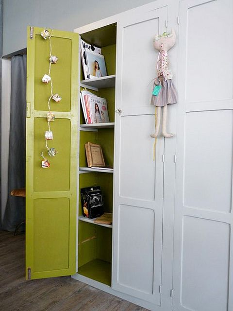 Cabinet with green painted interior | decor8, via Flickr  Not this green, but the concept