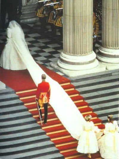 July 29, 1981:  Lady Diana Spencer marries Prince Charles at St. Paul's Cathedral in London.  Lady Diana and her 25 foot train. This photo gives us an idea of how long this train was. Amazing. She waits to walk down the aisle with her father.