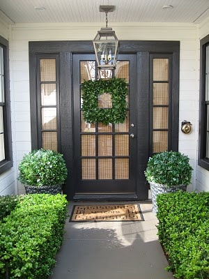 Black front door w/side lites and square wreath