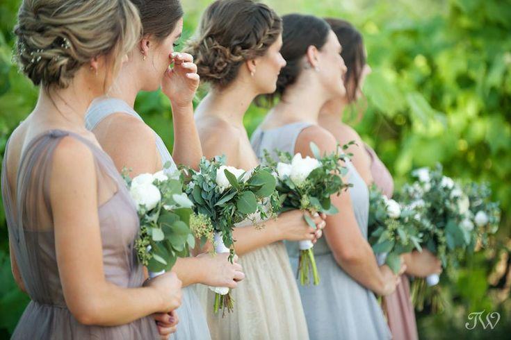 bridesmaids during vineyard wedding ceremony in Kelowna captured by Tara Whittaker Photography   Kelowna wedding photographer