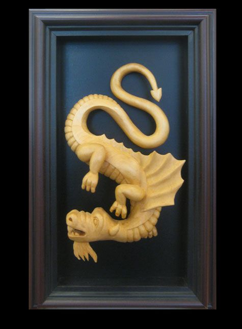 #41   Title: Dragon #6   Wood Carving   Artist: John Ottewill   Dimensions: 7 3/4 in. X 4 1/2 in.   Framed: 13 in. x 8 1/2 in.
