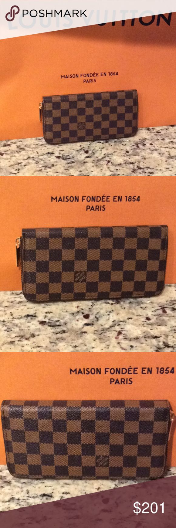 new Louis Vuitton damier full zip wallet Just make an offer All reasonable offers will be considered I will go much lower than the listed rate I have several to sell  This is a brand new Louis Vuitton damier full zip wallet with tons of card holding slots and a zipper inside for coins and cash this is a good quality INSPIRED or NOT AUTH piece i think bc i can't find a date stamp in it so I will sell this piece at a fraction of the cost of a real. The shopping bag in the background is not…