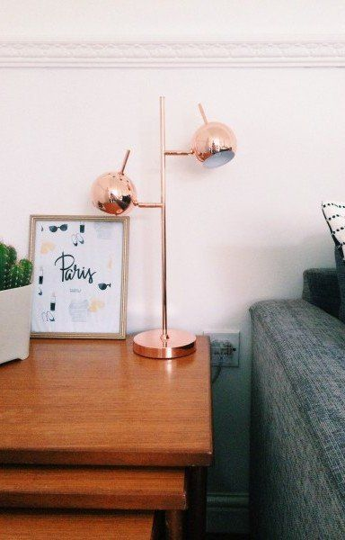 Catherine's Bedside table with her Austin Copper Table Lamp. | MADE.COM/Unboxed