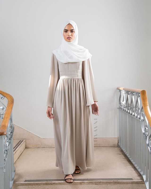 Designed with a flared cut for a relaxed fitting. Style with accessories for an everyday chic look.  Stone Maxi Dress with Binding Detail Off White Maxi Georgette HIjab  www.inayah.co