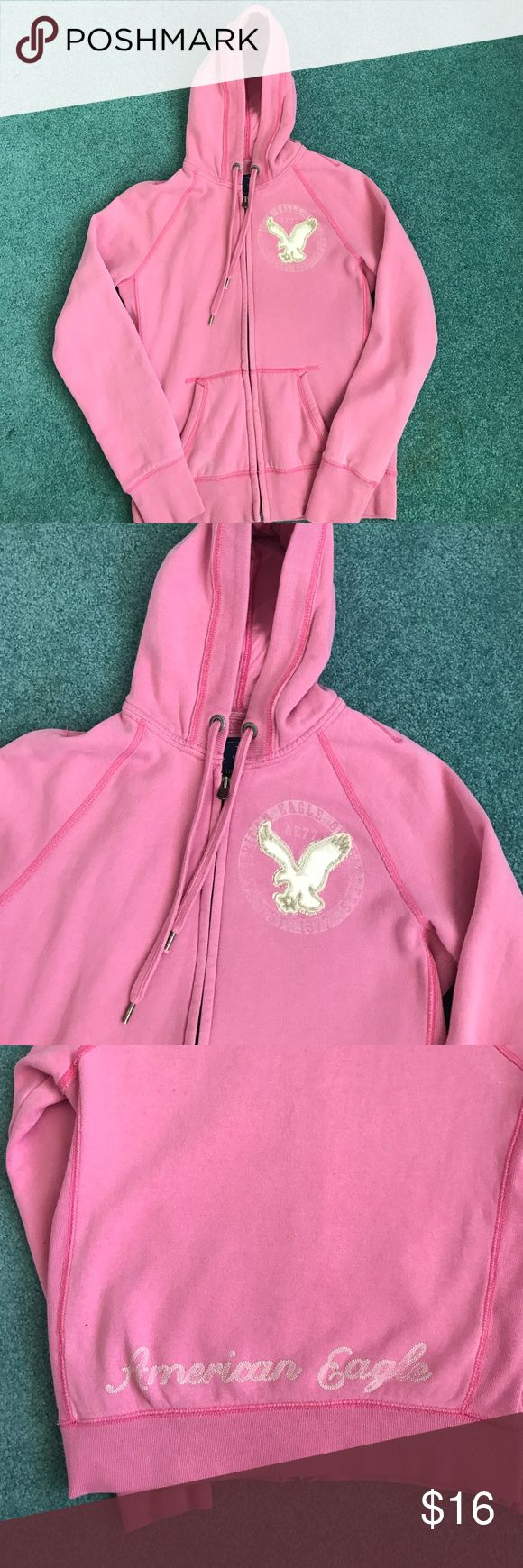American Eagle Juniors Pink zip up hoodie small This is an American Eagle Juniors Pink zip up hoodie size small. It is used but still in good condition. It has an eagle on the left chest, and says American Eagle across the bottom in the back. It has been washed. It never put in the dryer. It's made of 80% cotton and 20% polyester. American Eagle Outfitters Tops Sweatshirts & Hoodies